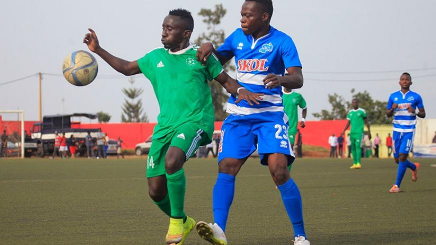 Kiyovu midfielder Jean Paul Havugimana, left, protects the ball against Pierrot Kwizera of Rayon Sports during the final game of last season, which the later won 2-1. 