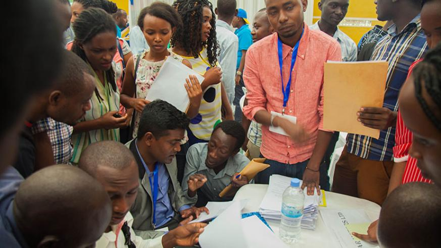 Youth submit applications during a job fair in Kigali. Some companies still discriminate female applicants. / File