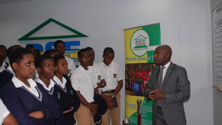 Rwabukumba talks to students during this year's Money Week in March. The local bourse still needs more products to attract new investors, like students, to the market. / File