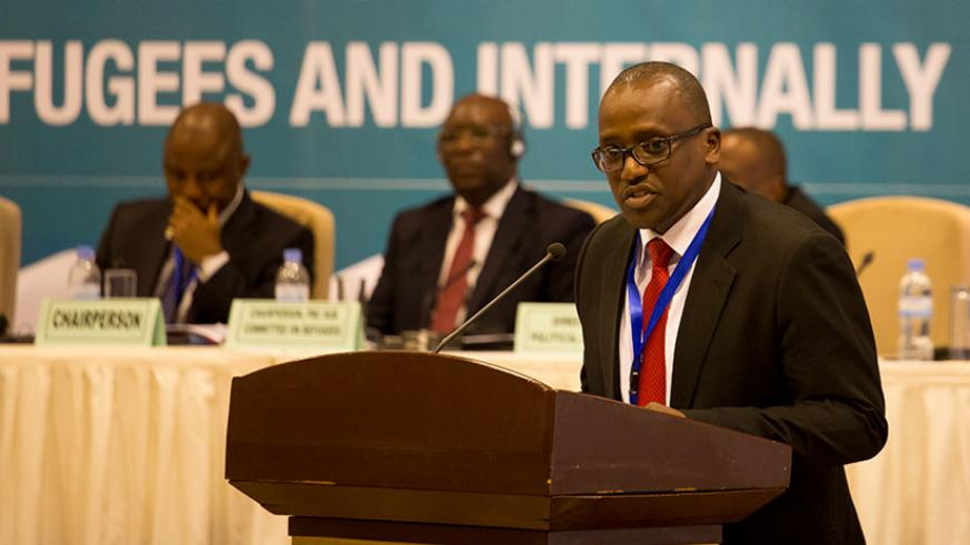 Claude Nikobisanzwe, the permanent secretary at Ministry of Foreign Affairs, Cooperation and East African Community Affairs, speaks at the opening of a weeklong meeting on the adop....