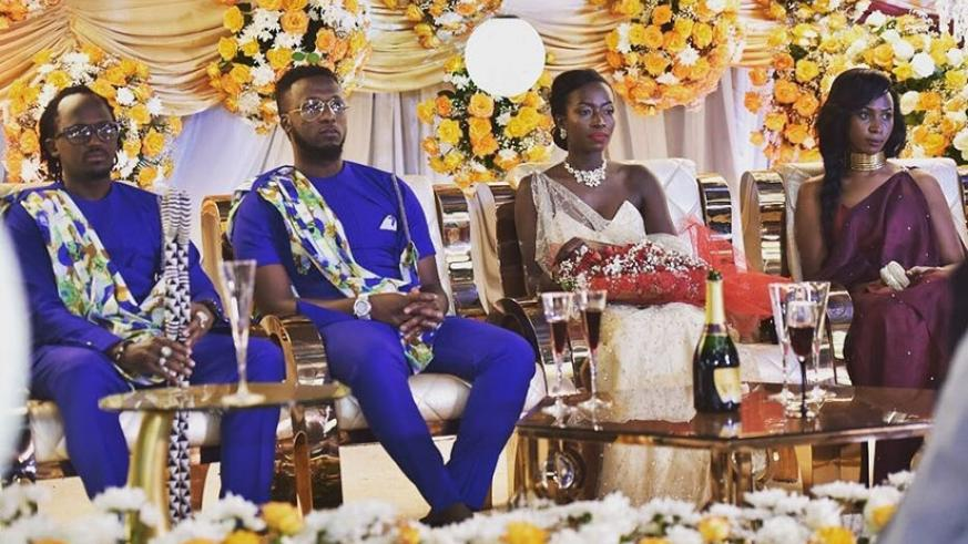 Safi and Niyonizera on their giveaway ceremony, flanked by their best man and maid of honour. (Courtesy)