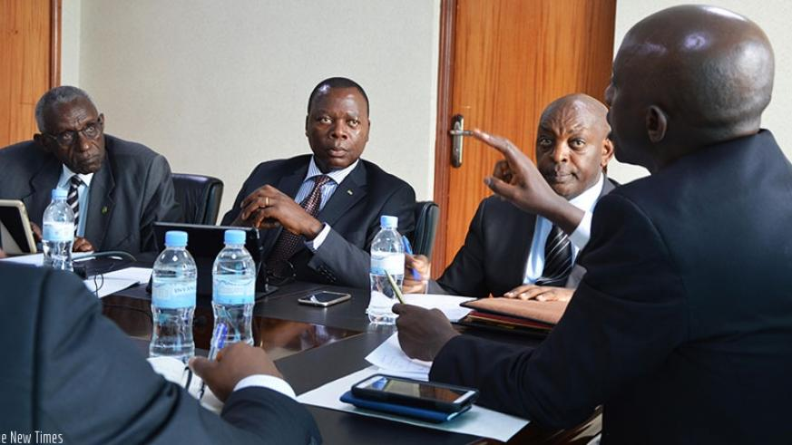 Members of the senatorial Standing Committee on Economic Development and Finance  listen to Local Government Minister Francis Kaboneka (R) during the meeting at the Ministry headqu....