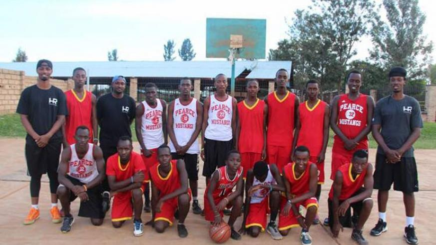 Hamza Ruhezamihigo (standing extreme right) and Lionel Hakizimana (standing extreme left) with young basketball players at New Life Christian Academy in Kayonza after a training se....