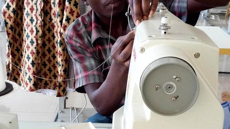 A Burera Garment Factory employee at work. The textile sector in the region has been challenged to find ways to improve production, create jobs. / File.