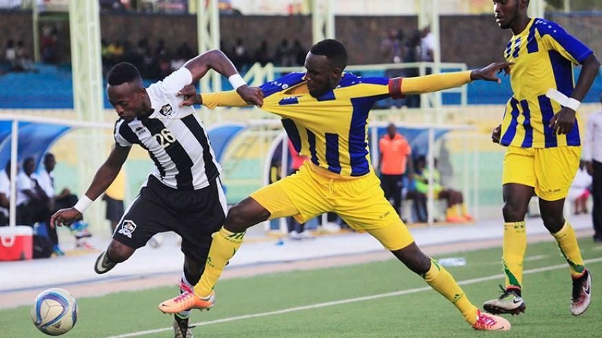 APR FC forward Issa Bigirimana battles for the ball with AS Kigali defenders last season. The winner of today's tie will go top of the league table. S. Ngendahimana.