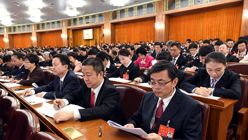 Delegates attend the 19th National Congress of the Communist Party of China (CPC) at the Great Hall of the People in Beijing, capital of China, Oct. 18, 2017. The CPC opened the 19....