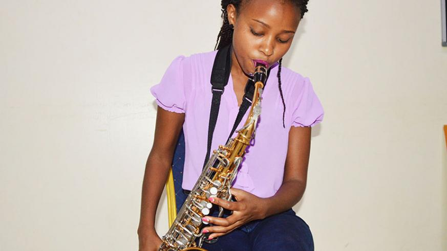 Stella Tushabe plays the saxophone mainly at church, weddings or for friends. / Sam Ngendahimana
