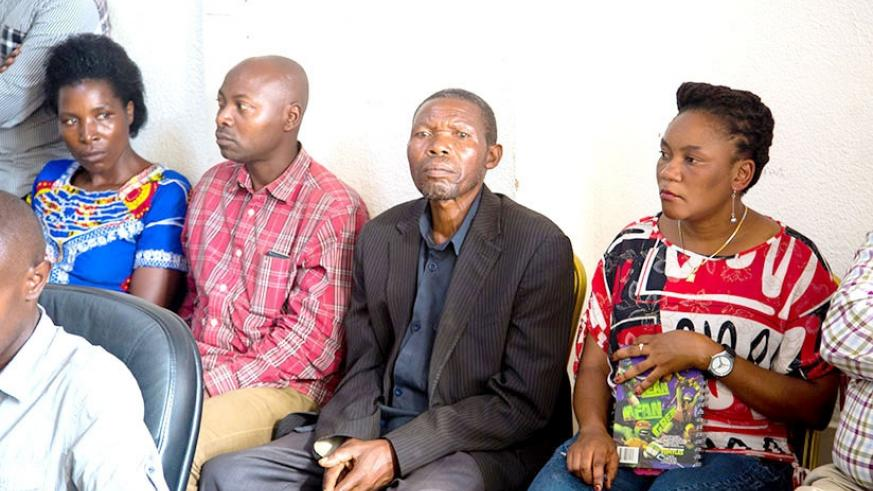 Alphonse Majyambere (second right), one of the seven Rwandans that Human Rights Watch falsely claimed had been killed by the country's security forces, and relatives of the othe....