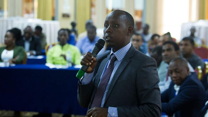 William Musoni, the RRA deputy commissioner for customs services, makes a presentation at the event yesterday. (Timothy Kisambira)