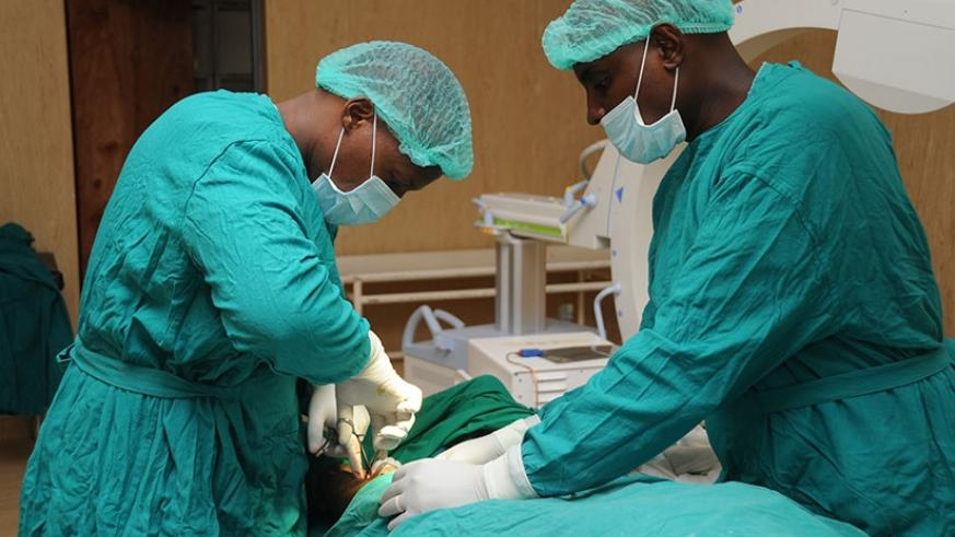 Doctors at Rwanda Military Hospital, Kanombe, perform an operation. (File)