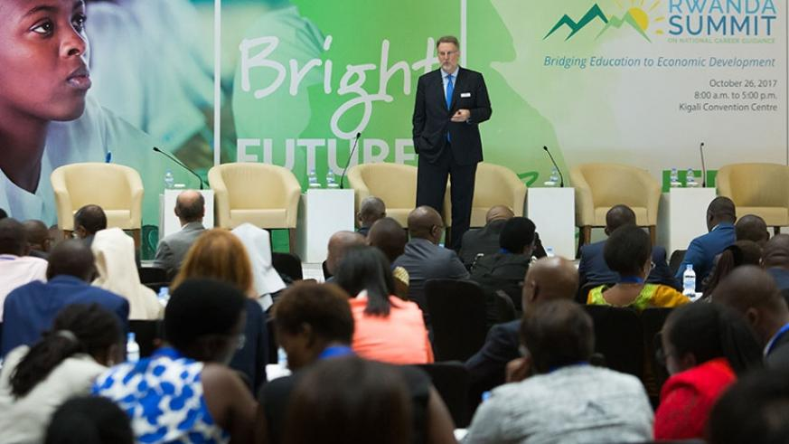 Dr Spencer Niles, senior vice-president for research at Kuder, speaks at the career summit in Kigali yesterday. Timothy Kisambira.