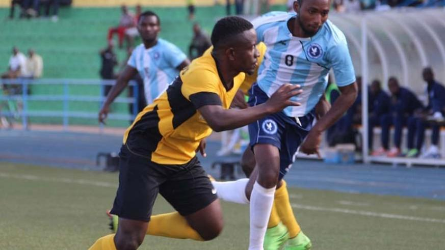 Jean Claude Zagabe, left, seen here up against Police FC forward Justin Mico, will again captain Mukura in the absence of Hussein Cyiza. Courtesy