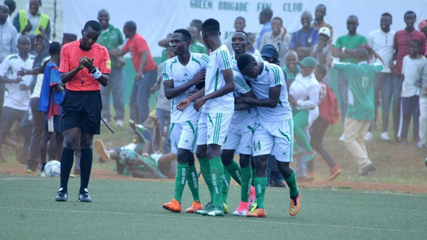 SC Kiyovu players mob goal scorer Francis Mustafa whose strike in the 32nd minute was enough to win his team a famous win over APR. / Courtesy