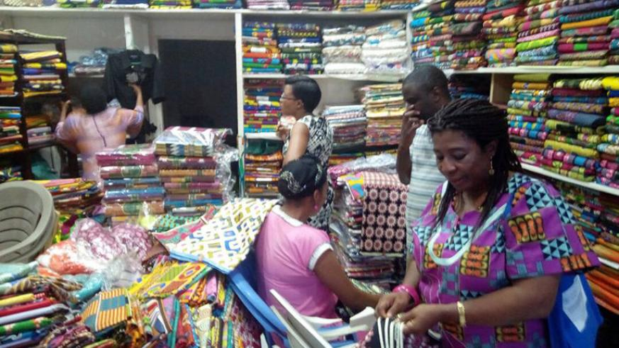 Inside one of the local shops. Accra has a number of shops that sell African fabrics. / Julius Bizimungu