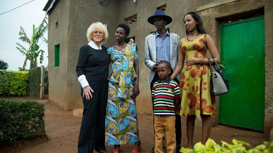 Leonille Mutsindakazi's family with Barbara Margolies, Head of International Organisation for Women and Development. / Timothy Kisambira