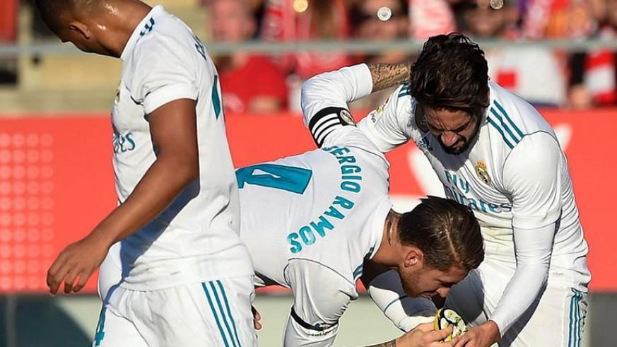 Sergio Ramos kissed the boot of Isco after the playmaker opened the scoring for his side. (Net photo)