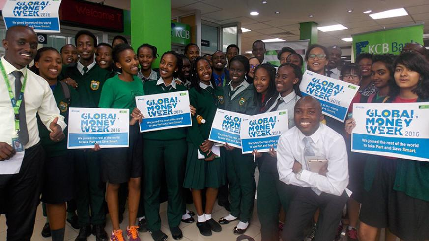 Green Hills students pose for a picture with KCB Bank staff during a study tour at one of the bank's branches as part of activities to mark last year's Global Money Week.