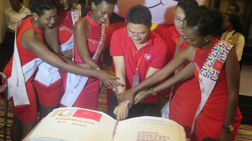 Itel Rwanda staff cutting the cake during the anniversary celebrations. (All photos by Eddie Nsabimana)