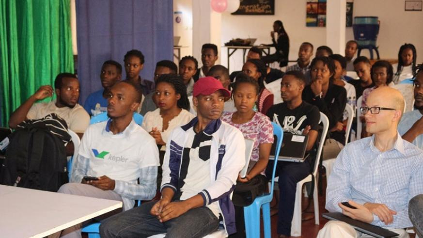 Students of Kepler university follow proceedings at the launch of the Hult Prize  competition. (Francis Byaruhanga)