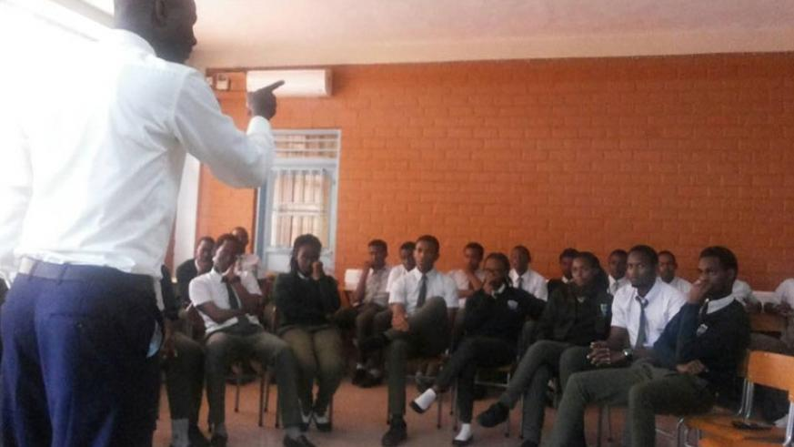 A teacher addresses students. Parents should complement teachers by being good role models to their children. (Lydia Atieono)