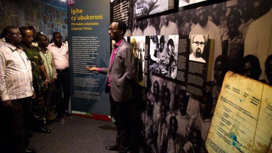 A guide at Kigali Memorial Centre explains to visitors about the 1994 Genocide against the Tutsi.  (File)