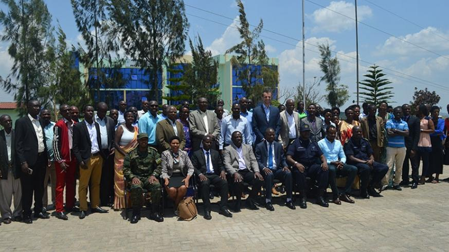 The Minister of State in charge of agriculture, Fulgence Nsengiyumva together with farmers, NGOs staff, District officials and other stakeholders in a group photo during the Cassav....