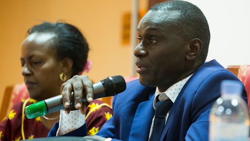 Dr Semwaga speaks at the workshop in Kigali yesterday. (Photos by Timothy Kisambira)