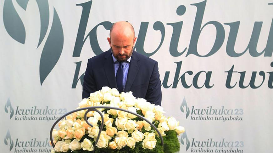 The  UK Special Envoy to the Great Lakes region Simon Mustard lays a wreath on the grave at Kigali Genocide Memorial yesterday  (All photos by Sam Ngendahimana)