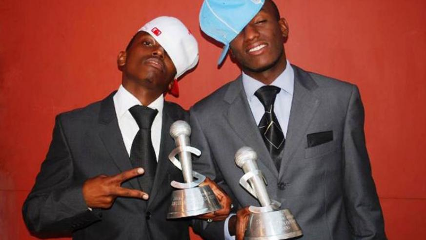 Singers Tom Close (L) and The Ben with their trophies at the 2009 Salax Awards. / File