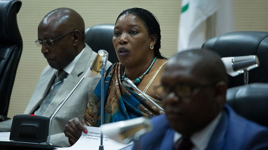 Nirere (centre)  briefs Parliament on the state of human rights in Rwanda  on Wednesday. (T. Kisambira)
