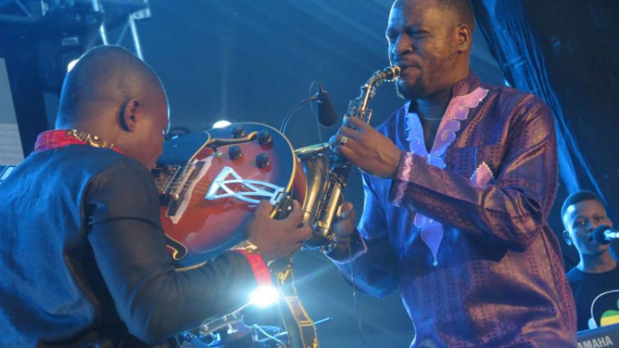 Katumwa (right) plays the saxophone at the 6th edition of Kigali Jazz Junction Season 3. The event took place at Kigali Serena hotel (big tent) on Friday. / Eddie Nsabimana