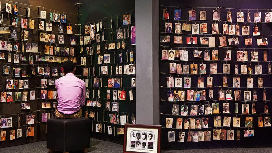 A man looks at the photos of some of the 1994 Genocide victims at Kigali Genocide Memorial. / File