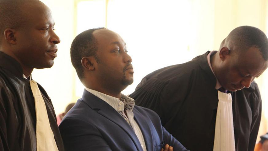 Evode Imena (C) accompanied by his lawyers appearSs before the judge. (Elisee Mpirwa)