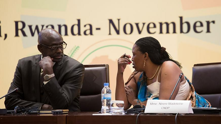 Minister Busingye (L) chats with Nirere during the meeting. (All photos by Timothy Kisambira)