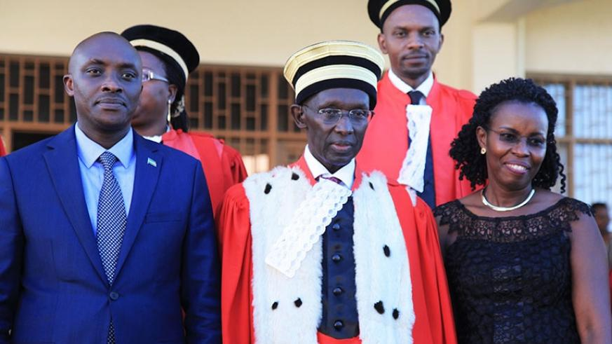 Chief Justice Sam Rugege (c) with new Rwanda Law Reform Commission chairperson Aimable Havugiyaremye (L) and deputy chairperson Beata Mukeshimana (R) after they were sworn in yeste....