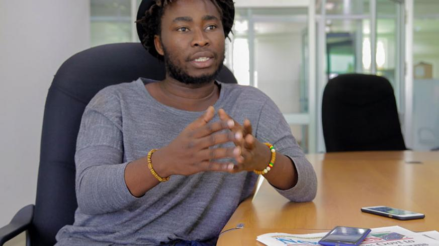 Documentary photographer Jacques Nkinzingabo during an interview at The New Times' head office on Monday, November 13. / Faustin Niyigena