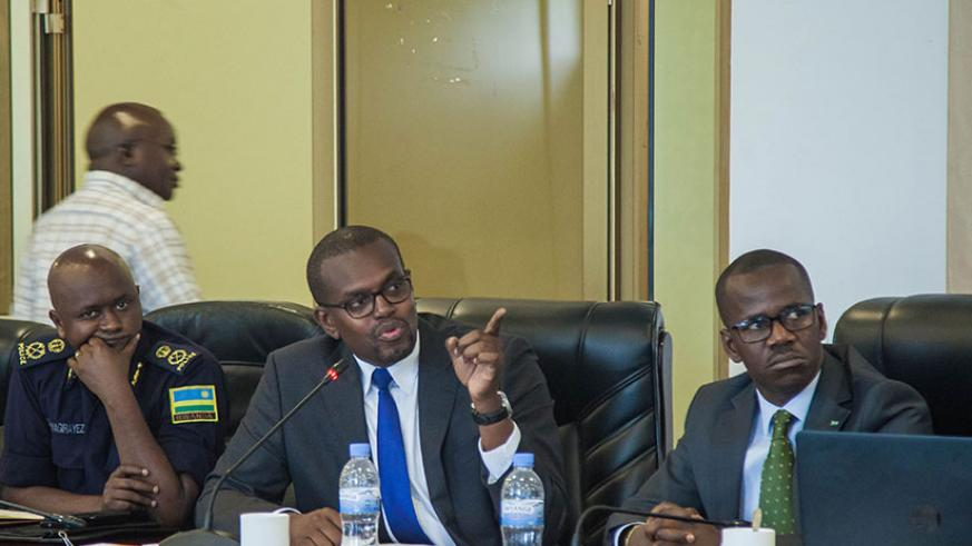 Mutangana (C) briefs the committee about drug dealing as State Minister for Legal Affairs Evode Uwizeyimana (R), and Jean-Marie Twagirayezu, the commissioner Police Criminal Invest....