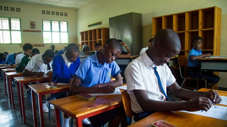 Candidates at Saint Ignace Primary School go through the examination papers on Monday. / Timothy Kisambira.