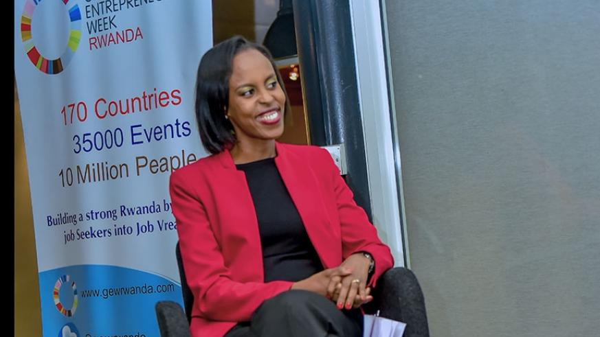 Kamikazi listens to other panelists during the event in Kigali, on Monday.  Courtesy.