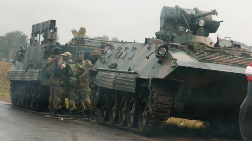 Soldiers stand beside military vehicles just outside Harare. / Internet photo