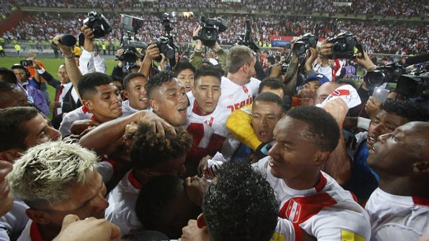 Peru's players celebrate wildly after a 2-0 win over New Zealand in Lima secured their place at the World Cup finals. (Net photo)