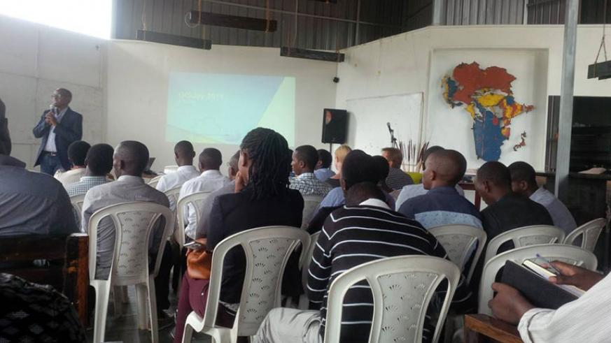 Some of the people who attended the GIS Day event in Kigali listen to presentations. / Joan Mbabazi