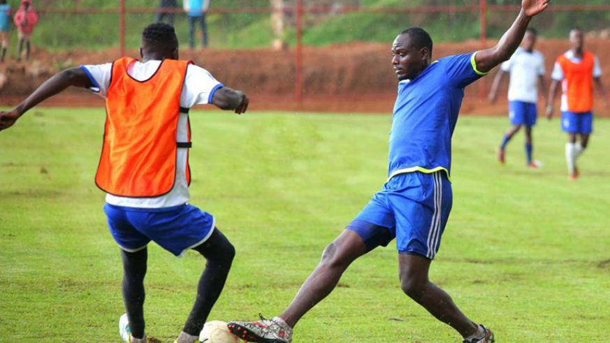 Katauti, right, is said to have played a full 90 minutes in a Rayon Sports training match on Tuesday, only hours before his sudden death. / Internet photo