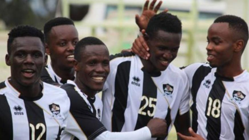 Full-back Fitina Omborenga, 2nd from right, is congratulated by teammates after giving APR the lead in the 3-0 win over Bugesera on Wednesday. Sam Ngendahimana.
