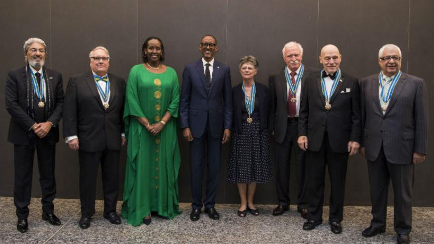 President Paul Kagame with seven Igihango National Order of Friendship medal recipients Hezi Bezalel, Gilbert R. Chagoury, John W. Dick, Dr. Paul Farmer, Howard Buffet, Prof. Linda....