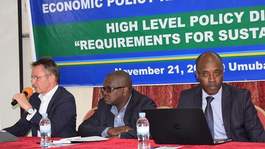 Dr Hermann Boemel, the GIZ programme manager, speaks at the policy dialogue on Tuesday. Rugwabiza (centre) and Prof Ndahirirwe listen to the presentation. (Lydia Atieno)