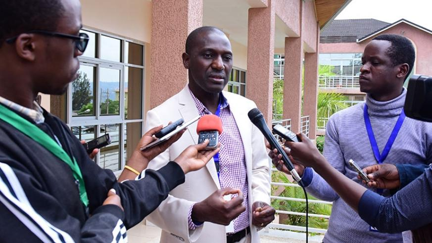 Sanou Dia, from FAO, speaks to journalists after the meeting. (Photos by Michel Nkurunziza)