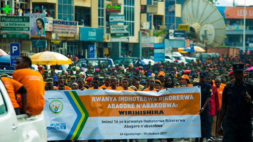 A walk to raise awareness about call to end violence against women and girls in Kigali yesterday. The walk also helped call on the role of different actors and the community in dea....
