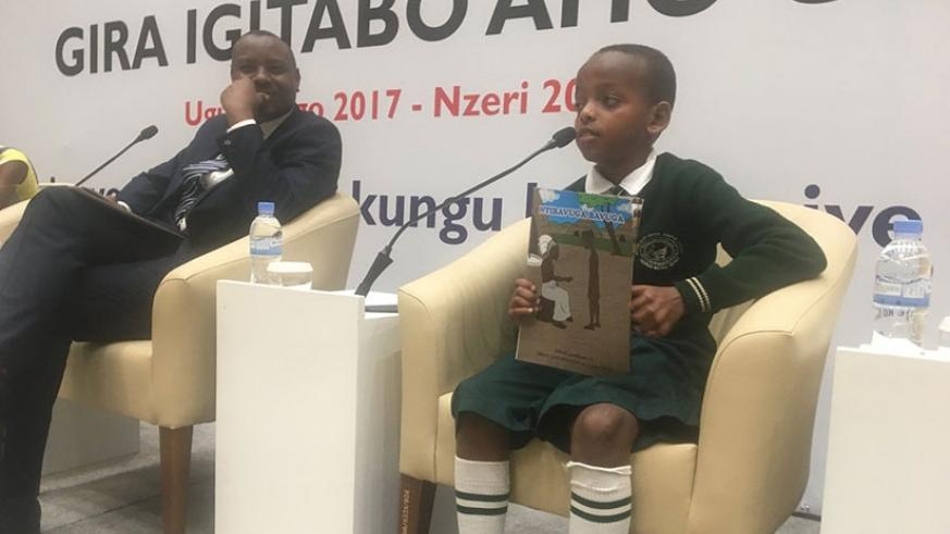 Cyusa, the author of a story book, Ntibavuga Bavuga, on the panel discussion with Minister Isaac Munyakazi. / Diane Mushimiyimana.