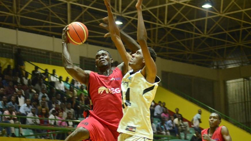 REG player Bienvenue Ngandu goes to the rim in a league game against Patriots last season. The two rivals face-off in the semi-final of this year's pre-season tournament on Saturday. File